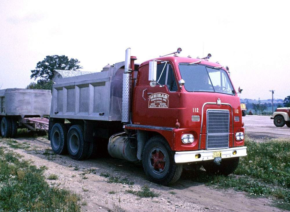 Hribar Logistics vintage truck with dump bed and trailer
