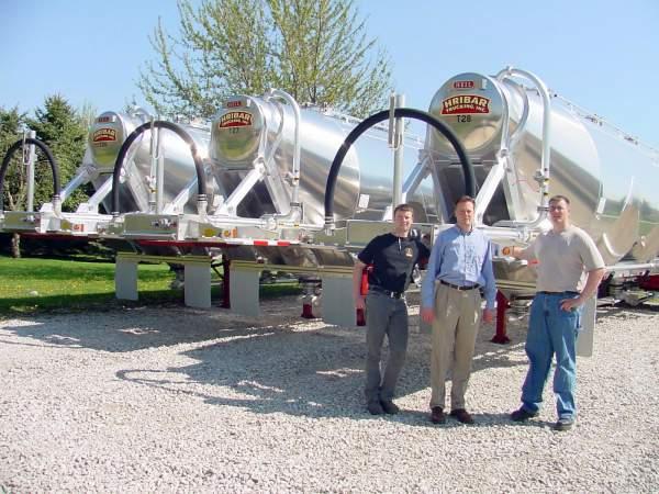 three pneumatic tank trailers lined up, Hribar Logistics