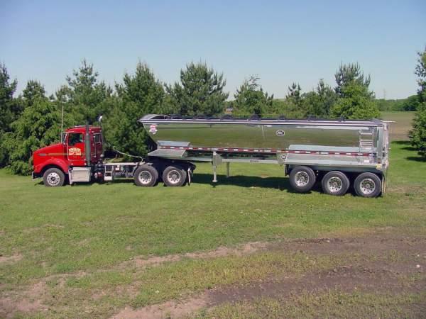 Hribar Logistics truck pulling a dump end trialer