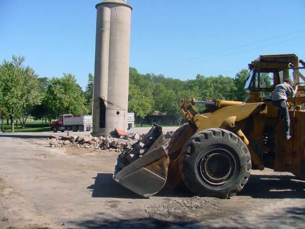 A tractor, truckn and silo at the Hribar family farm