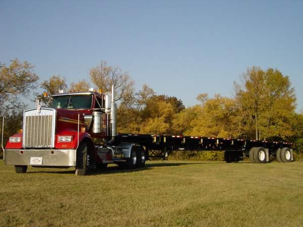 Hribar Logistics truck pulling a flatbed trailer