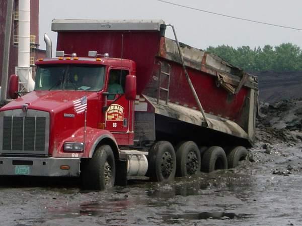 Hribar Logistics dump truck driving through mud