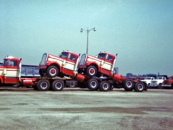 Hribar Logistics trucks being transported, old photograph