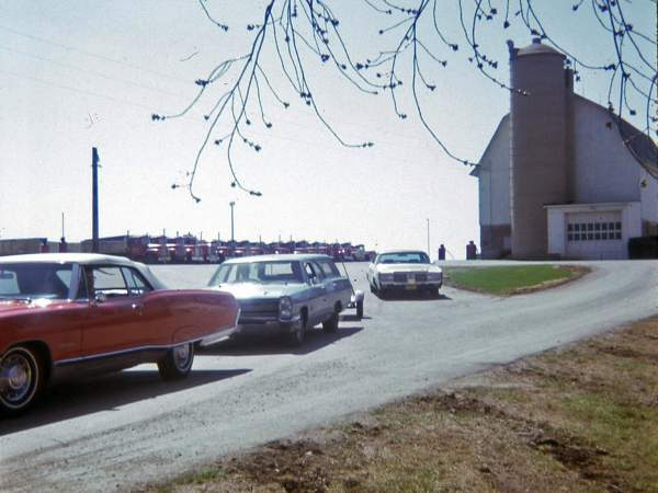 Hribar Logistics fleet and cars in front of the Hribar family farm, old photograph