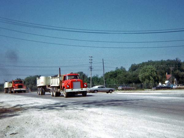 "Hribar Logistics dump truck pulling ""Pup"" trailer, viewed from the front"